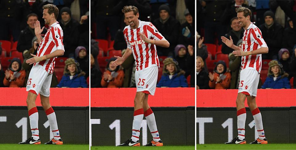 """A combination photo shows Stoke City's English striker Peter Crouch do his """"robot"""" celebration as he celebrates scoring his team's first goal, and his 100th Premiere League goal, during the English Premier League football match between Stoke City and Everton at the Bet365 Stadium in Stoke-on-Trent, central England on February 1, 2017. / AFP PHOTO / Paul ELLIS / RESTRICTED TO EDITORIAL USE. No use with unauthorized audio, video, data, fixture lists, club/league logos or 'live' services. Online in-match use limited to 75 images, no video emulation. No use in betting, games or single club/league/player publications.  /         (Photo credit should read PAUL ELLIS/AFP via Getty Images)"""