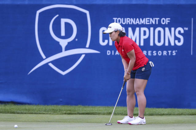 Nasa Hataoka, of Japan, looks over the 18th green before putting during extra holes in the Tournament of Champions LPGA golf tournament Sunday, Jan. 19, 2020, in Lake Buena Vista, Fla. After five extra holes, Hataoka and Gaby Lopez, of Mexico, will return on Monday to break the tie. John Smoltz, former baseball pitcher, won the celebrity field. (AP Photo/Gary McCullough)