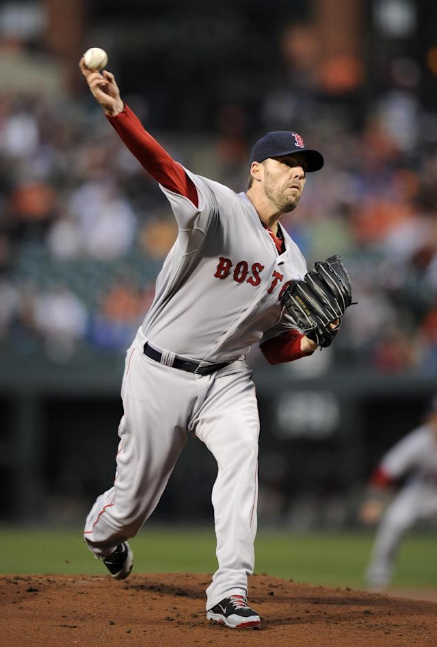 Boston Red Sox starting pitcher John Lackey delivers a pitch during the first inning of a baseball game against the Baltimore Orioles, Wednesday, April 2, 2014, in Baltimore. (AP Photo/Nick Wass)