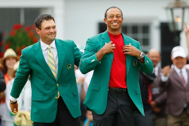 Tiger Woods (R) won his first major tournament in 11 years when he took the Masters on Sunday (AFP Photo/Kevin C. Cox)