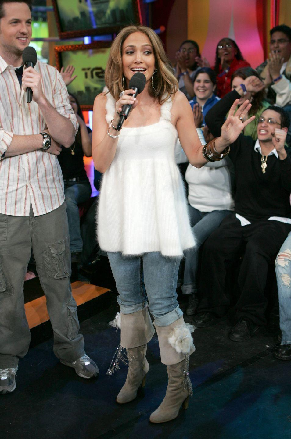 <p>If you ever have trouble sleeping, you could count J.Lo's shirt to fall asleep. The singer not only looked like a sheep in this fuzzy sweater tank top, but her boots also had a fuzzy situation going on. Just...too much. </p>