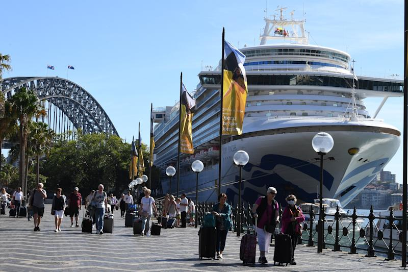 Cruise ship passengers disembark from the Princess Cruises owned Ruby Princess at Circular Quay in Sydney.