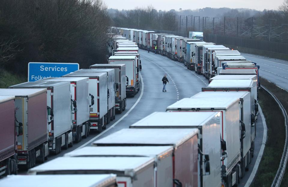 Lorry drivers walk about on the M20 in Kent where freight traffic is parked up near to Folkestone services whilst the Port of Dover remains closed.