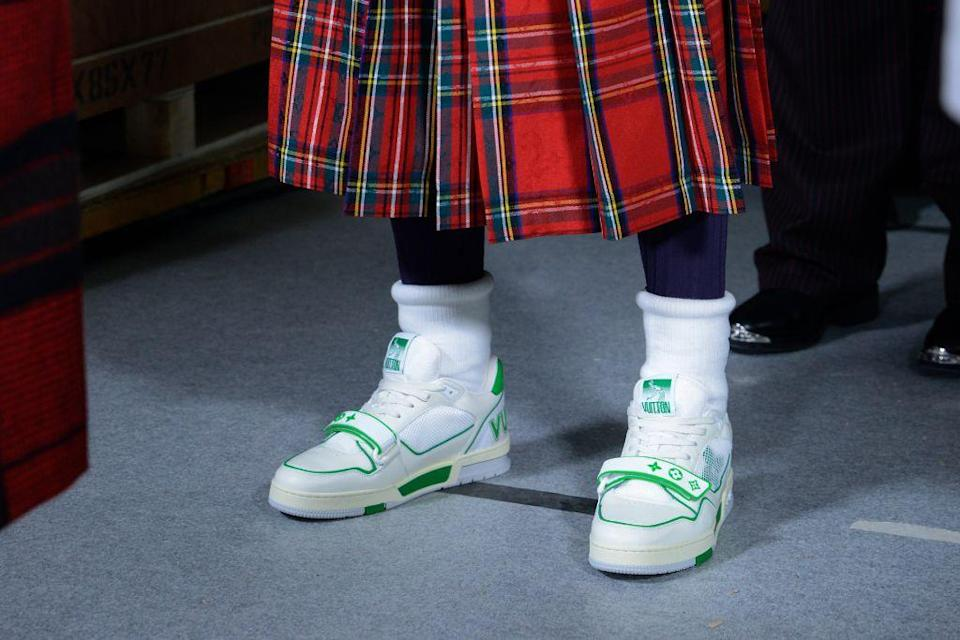 Sneakers and kilts at Louis Vuitton fall '21 men's. - Credit: Courtesy of Louis Vuitton