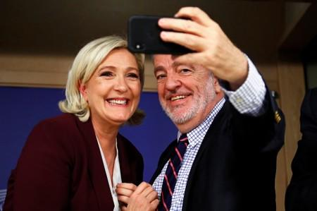 French far-right National Rally party leader Le Pen poses for a selfie with Belgium's MEP Annemans at the EU Parliament in Brussels