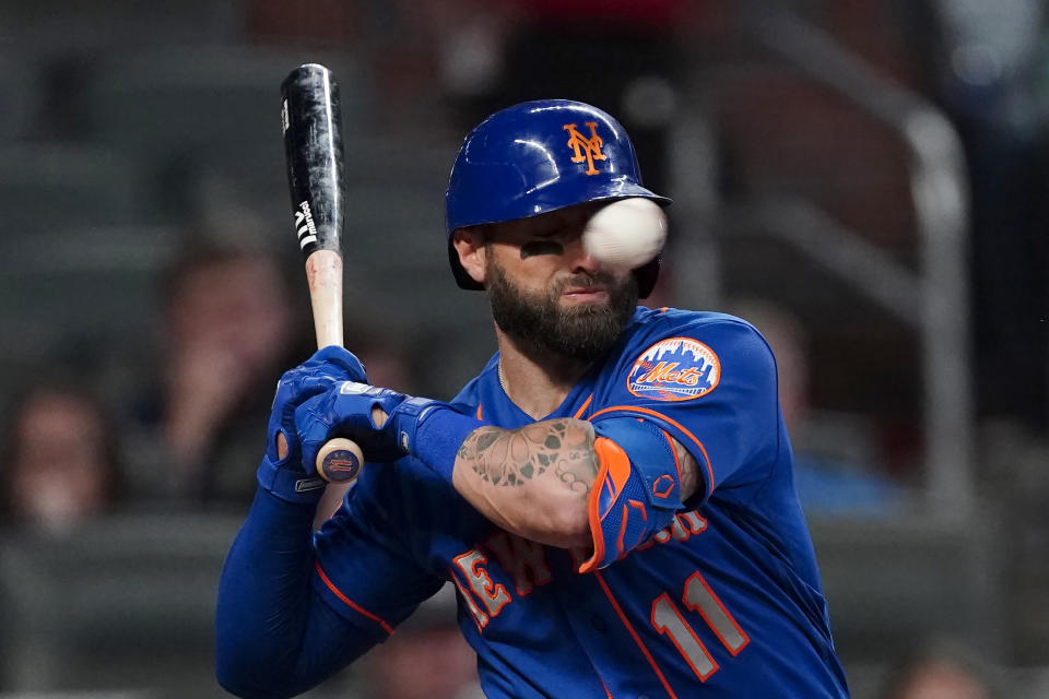 New York Mets' Kevin Pillar is hit in the face with a pitch from Atlanta Braves pitcher Jacob Webb in the seventh inning of a baseball game Monday, May 17, 2021, in Atlanta. (AP Photo/John Bazemore)