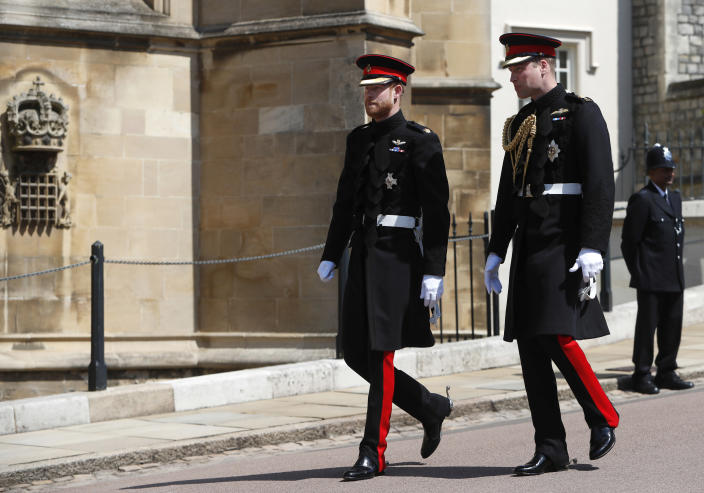 FILE - In this file photo dated Saturday, May 19, 2018, Britain's Prince Harry, left, arrives with his best man Prince William for his wedding ceremony to Meghan Markle at St. George's Chapel in Windsor Castle in Windsor, England. When Prince Harry attends Prince Philip's funeral on Saturday April 17, many be watching for signs of reconciliation between Prince Harry and his family, especially with his elder brother Prince William. (AP Photo/Alastair Grant, FILE)