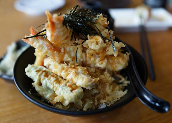 Tendon is crunchy and salty seafood tempura served on rice.