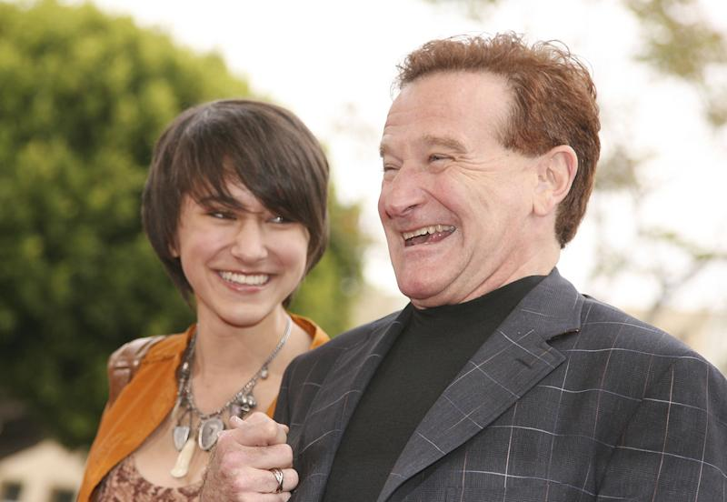 "LOS ANGELES - APRIL 23: Actor Robin Williams (R) and daughter Zalda pose at the premiere of Columbia Picture's ""RV"" at the Village Theater on April 23, 2006 in Los Angeles, California. (Photo by Kevin Winter/Getty Images)"