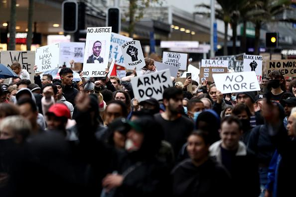 Protesters march down Queen Street in Auckland, New Zealand.