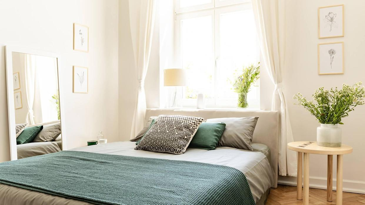 Eco cotton linen and blanket on a bed in nature loving family guesthouse for spring and summer vacation.