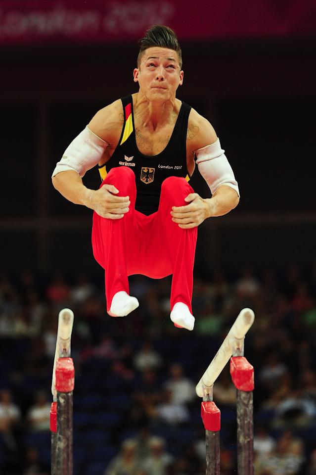 LONDON, ENGLAND - JULY 28:  Marcel Nguyen of Germany competes in the parallel bars in the Artistic Gymnastics Men's Team qualification on Day 1 of the London 2012 Olympic Games at North Greenwich Arena on July 28, 2012 in London, England.  (Photo by Mike Hewitt/Getty Images)
