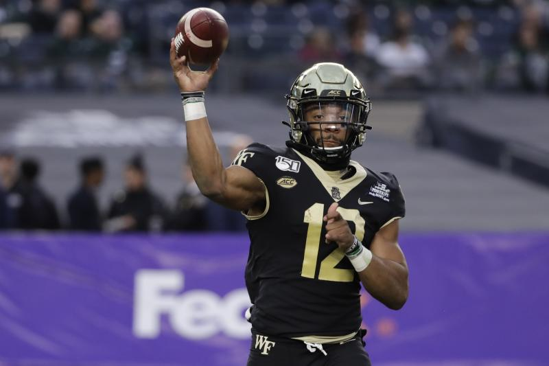 Wake Forest quarterback Jamie Newman (12) throws a pass during the first half of the Pinstripe Bowl NCAA college football game against Michigan State Friday, Dec. 27, 2019, in New York. (AP Photo/Frank Franklin II)