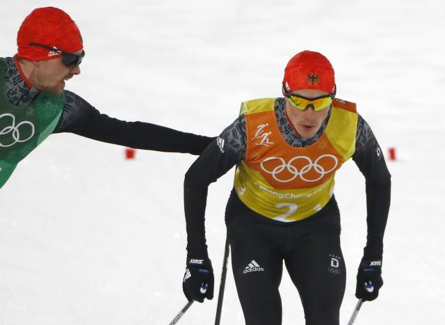 Nordic Combined Events - Pyeongchang 2018 Winter Olympics - Men's Team 4 x 5 km Final - Alpensia Cross-Country Skiing Centre - Pyeongchang, South Korea - February 22, 2018 - Fabian Riessle of Germany tags teammate Eric Frenzel. REUTERS/Dominic Ebenbichler