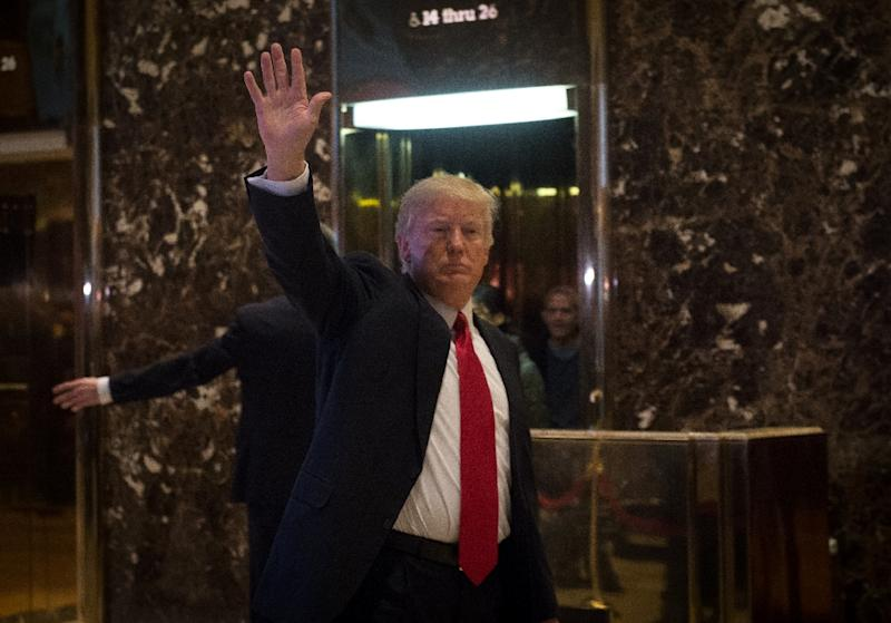 US President-elect Donald Trump, seen January 13, 2017, faces growing opposition to rapprochement within his own Republican party, amid allegations that a hacking campaign ordered by Moscow aimed to tip the election in his favor (AFP Photo/Bryan R. Smith )