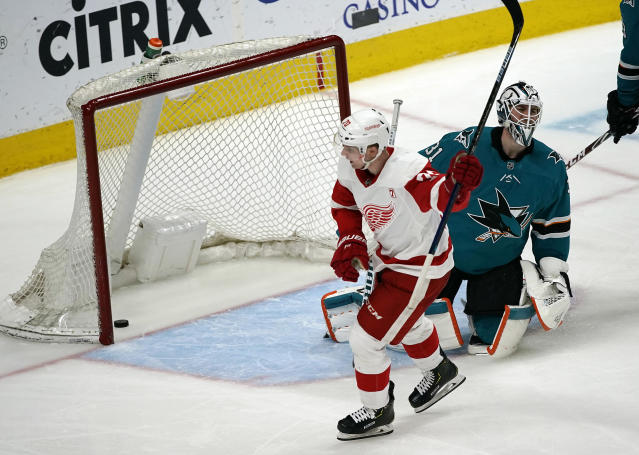 Detroit Red Wings center Christoffer Ehn (70) celebrates after scoring a goal past San Jose Sharks goaltender Martin Jones (31) during the third period of an NHL hockey game Monday, March 25, 2019, in San Jose, Calif. (AP Photo/Tony Avelar)