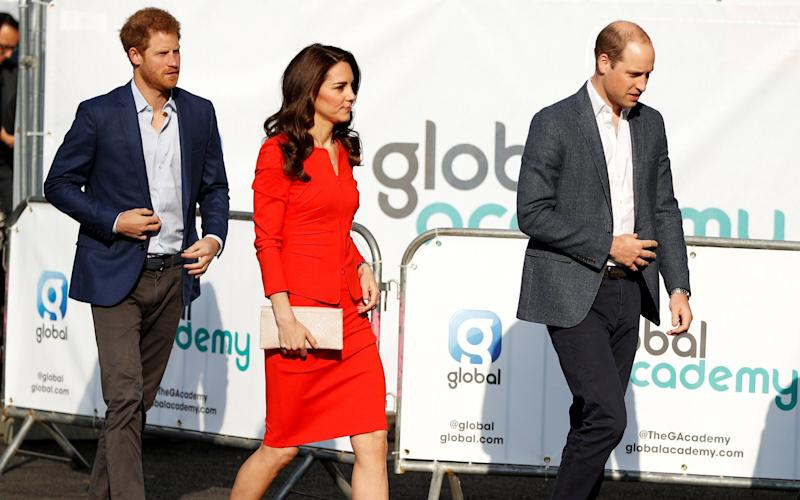 Prince William, Prince Harry and Catherine, the Duchess of Cambridge, arrive to open the Global Academy - Credit:  REUTERS