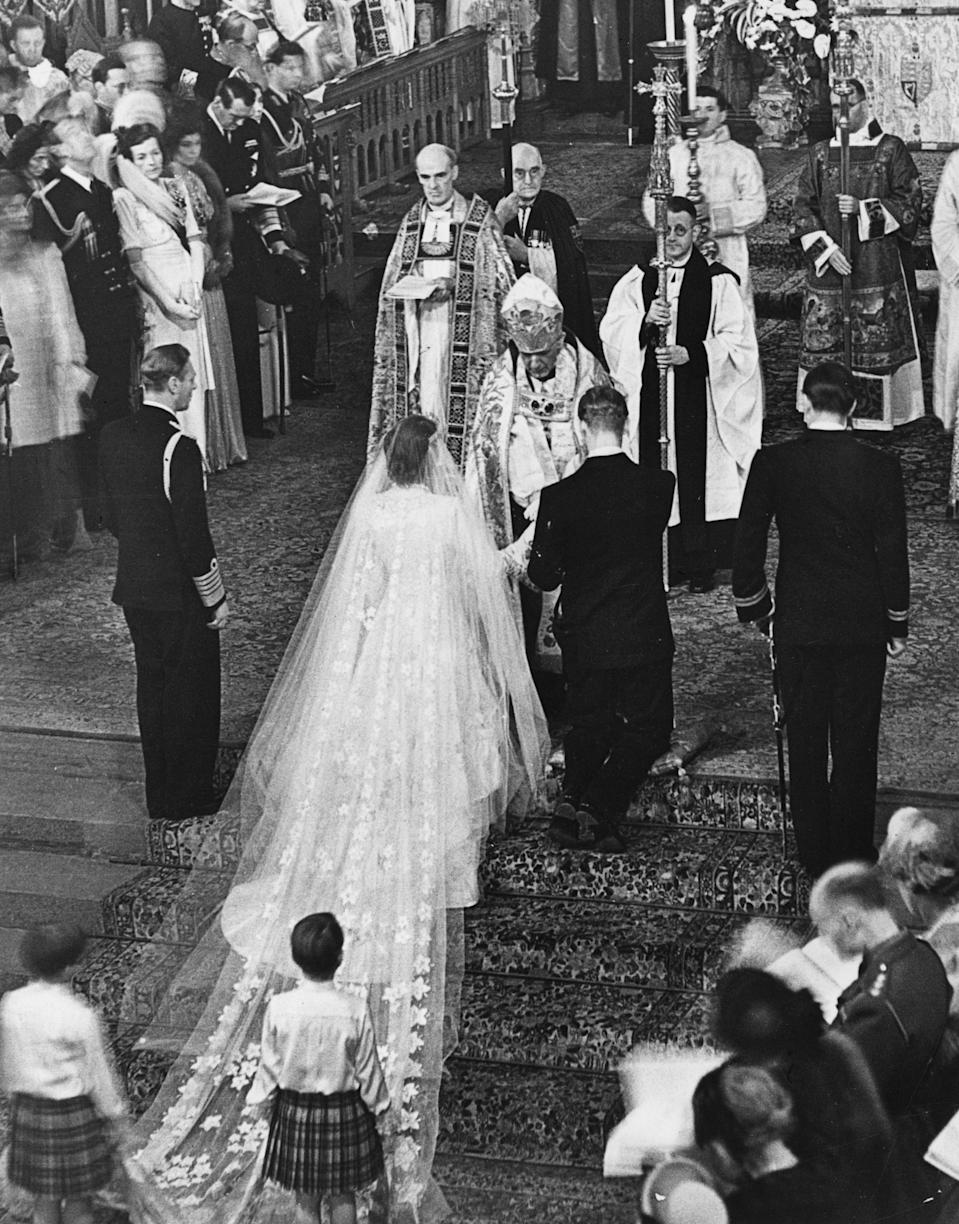 20th November 1947:  The Queen and The Duke of Edinburgh receiving a blessing from the Archbishop of Canterbury Lord Fisher (1887 - 1972) on the occasion of their wedding.  (Photo by Central Press/Getty Images)