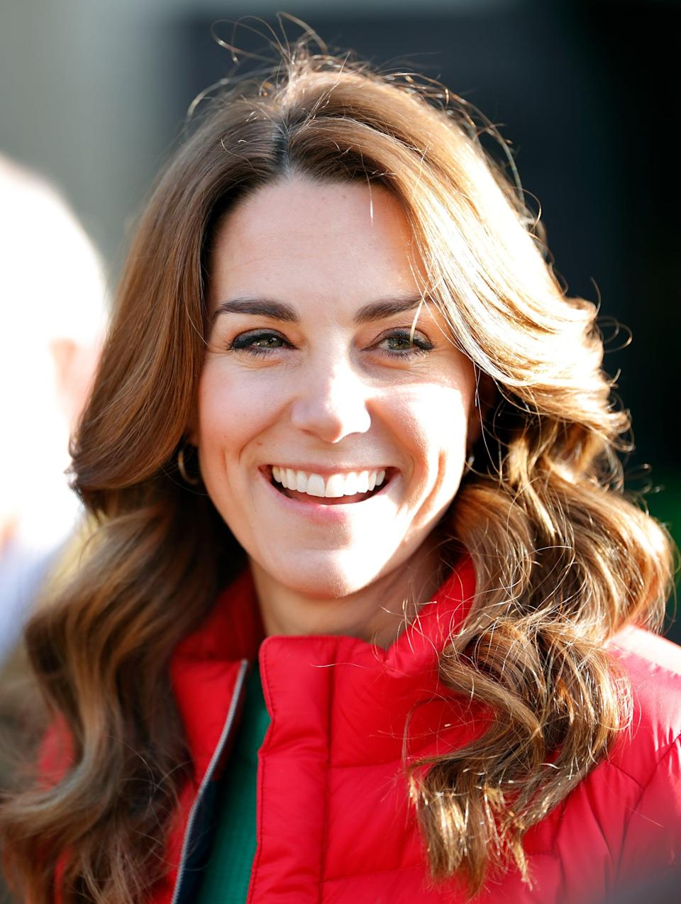 <p>For a charity outing during the festive season, the duchess stepped out with an enviable blowout that featured both bouncy volume and shiny, perfectly-shaped waves </p>