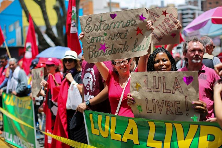 Supporters of Brazil's former president Luiz Inacio Lula da Silva demonstrate outside a federal court in Curitiba