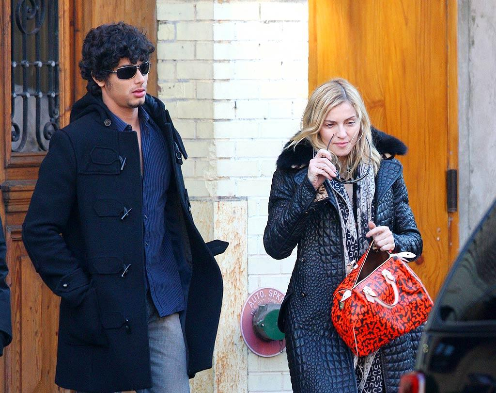 """If we can't have Madonna's Louis Vuitton handbag, can we at least borrow her new man, 22-year-old model Jesus Luz? <a href=""""http://www.splashnewsonline.com"""" target=""""new"""">Splash News</a> - February 2, 2009"""