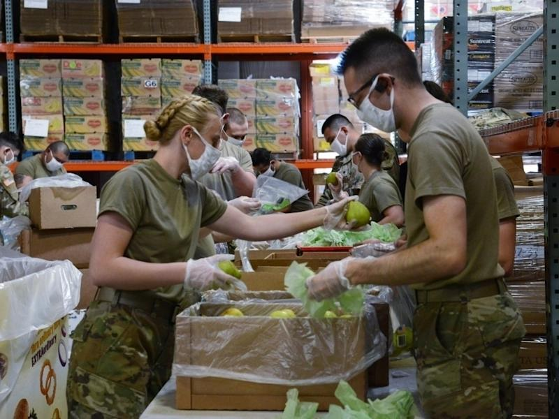 Washington National Guard members help pack food for the Second Harvest Food Bank in Pasco on May 13, 2020.