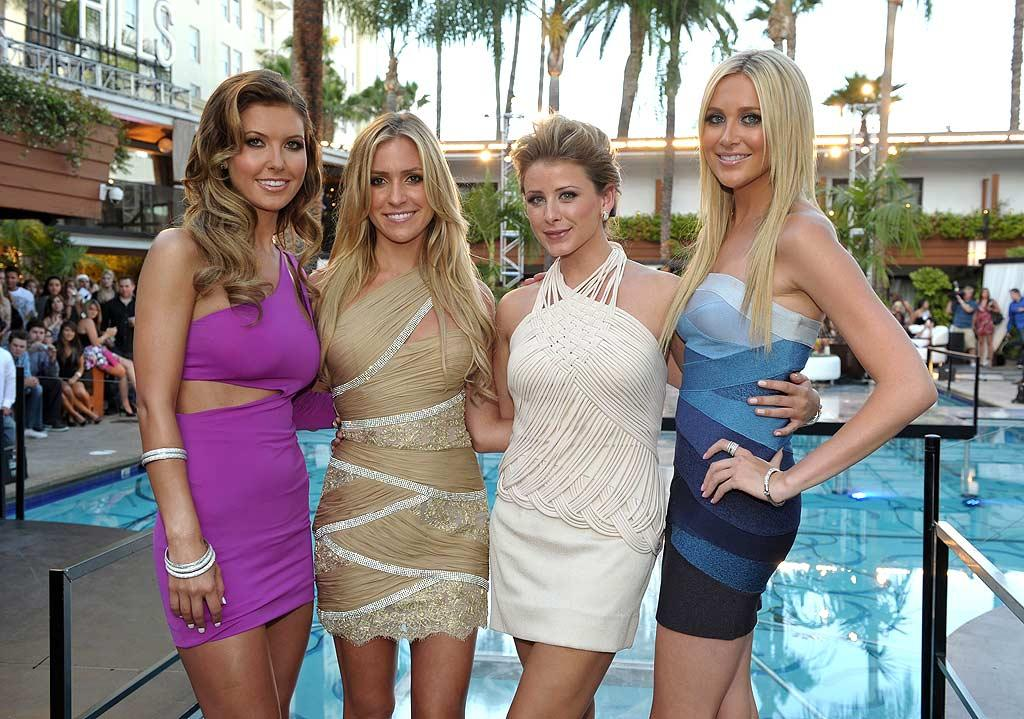 "Sporting a striking purple Boulee dress, Audrina posed poolside with Kristin, Lo (in a cream a Tadashi Shoji mini), and Stephanie. Are the awesome foursome truly friends in real life? John Shearer/<a href=""http://www.gettyimages.com/"" target=""new"">GettyImages.com</a> - July 13, 2010"