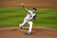 Kansas City Royals starting pitcher Jonathan Heasley throws during the second inning of a baseball game against the Seattle Mariners Friday, Sept. 17, 2021, in Kansas City, Mo. (AP Photo/Charlie Riedel)