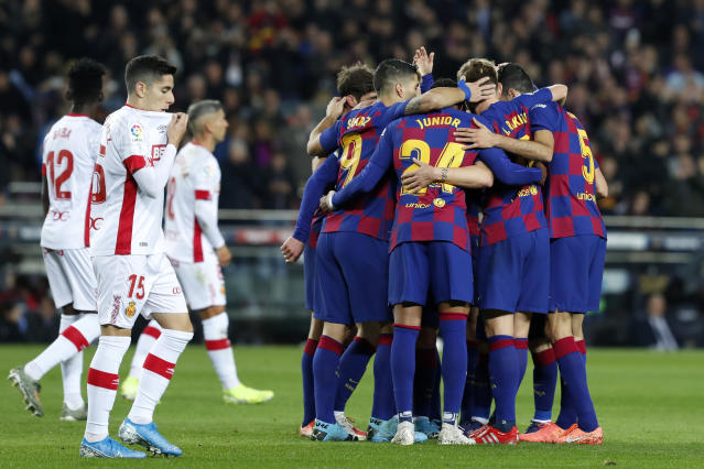 Barcelona players celebrate their second goal during a Spanish La Liga soccer match between Barcelona and Mallorca at Camp Nou stadium in Barcelona, Spain, Saturday, Dec. 7, 2019. (AP Photo/Joan Monfort)