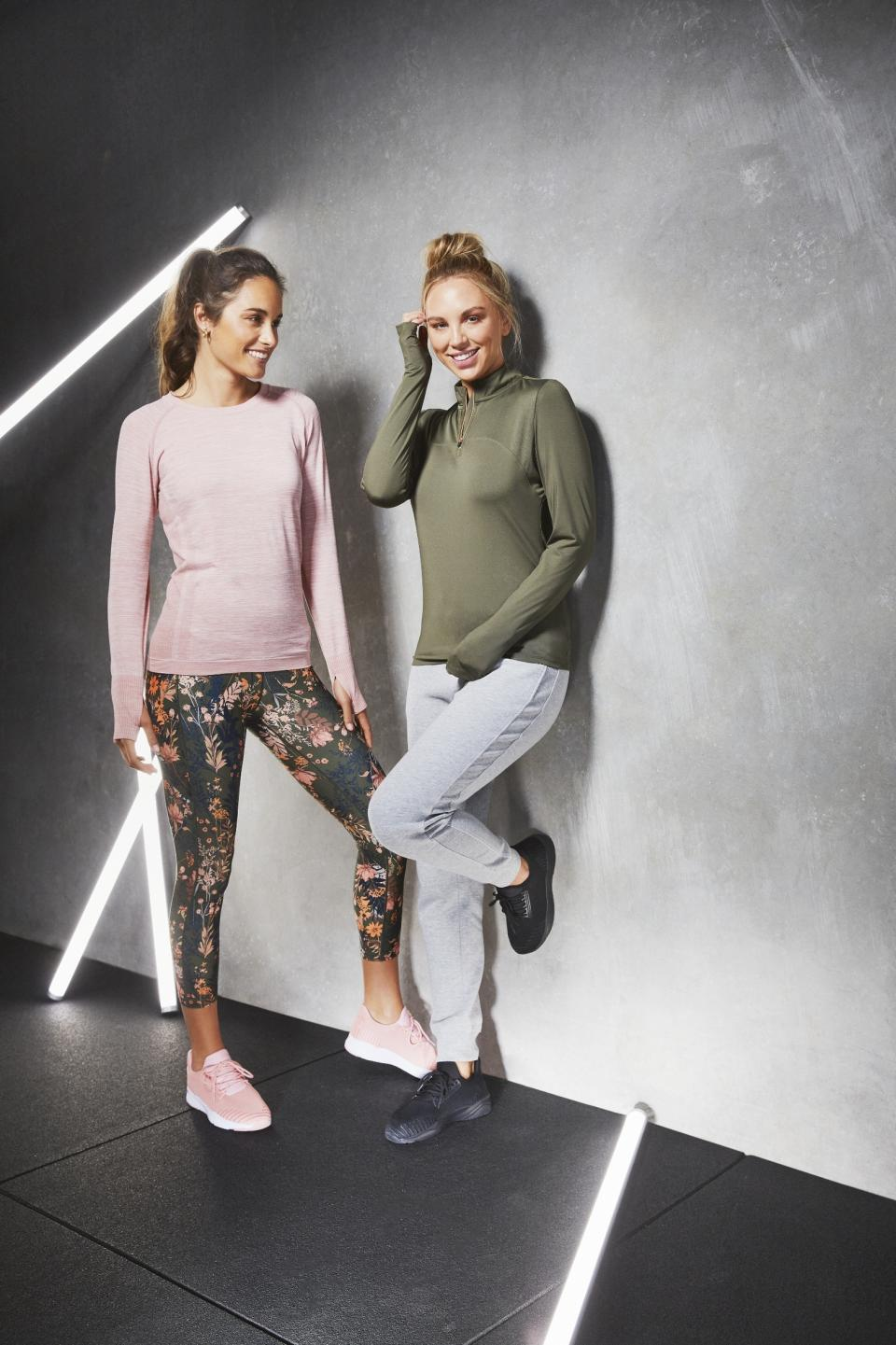 Two female models wearing long-sleeve tops and leggings from Aldi's activewear range