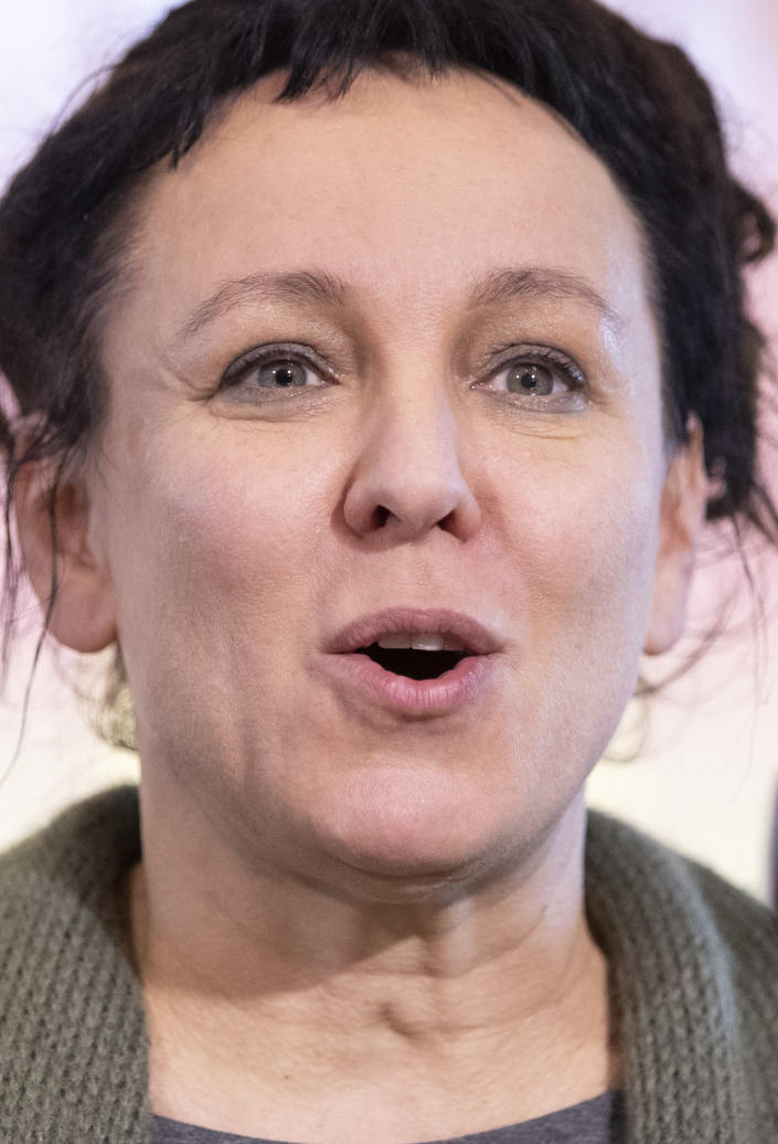 Polish author Olga Tokarczuk attends a press conference in Bielefeld, Germany, Thursday, Oct 10, 2019. Olga Tokarczuk is named recipient of the 2018 Nobel Prize in Literature, Thursday Oct. 10, 2019. Two Nobel Prizes in literature are announced Thursday after the 2018 literature award was postponed following sex abuse allegations that rocked the Swedish Academy at that time. (Friso Gentsch/dpa via AP)