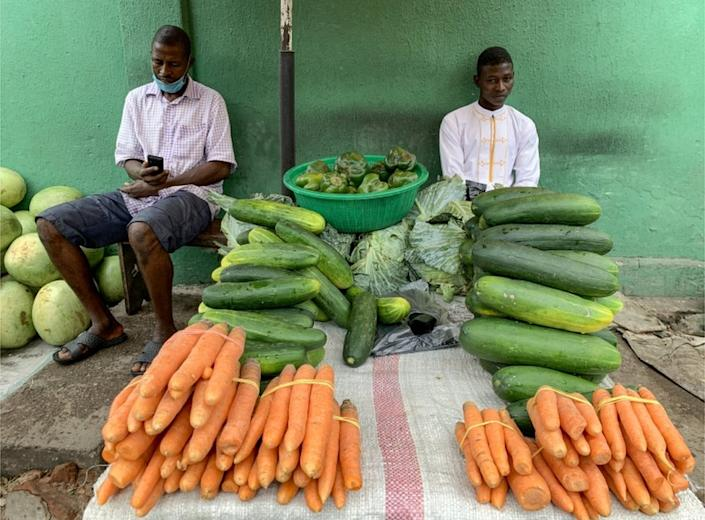 Also on Tuesday, vegetable sellers in Nigeria's commercial capital, Lagos, stand by their products.