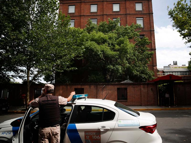 A police officer stands in front of the Faena Art Hotel in Buenos Aires, hours after Saturday's attack: AP