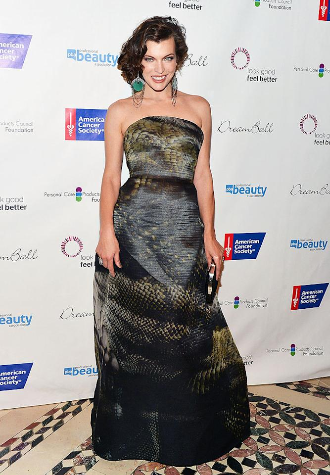 """Milla Jovovich never fails to impress us in the fashion department, and she once again made us proud at this year's DreamBall Gala at Cipriani Wall Street. Oozing confidence, the """"Resident Evil"""" action heroine hit the arrivals line in statement earrings, a wavy 'do, and a reptilian masterpiece, courtesy of Armani Prive. (9/27/2012)<br><br>See the trailer for <a target=""""_blank"""" href=""""http://movies.yahoo.com/movie/resident-evil-retribution/"""">""""Resident Evil: Retribution""""</a>"""