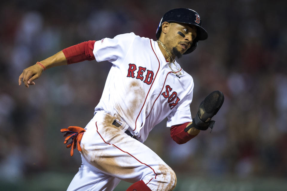 BOSTON - JULY 16: Boston Red Sox right fielder Mookie Betts (50) rounds third base on his way to score during the bottom of the fifth inning. The Boston Red Sox host the Toronto Blue Jays in a regular season MLB baseball game at Fenway Park in Boston on July 16, 2019. (Photo by Nic Antaya for The Boston Globe via Getty Images)