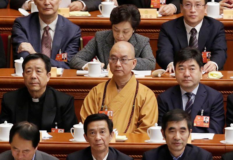 Chinese monk accused of sexual harassment resigns as chairman of Buddhist Association of China
