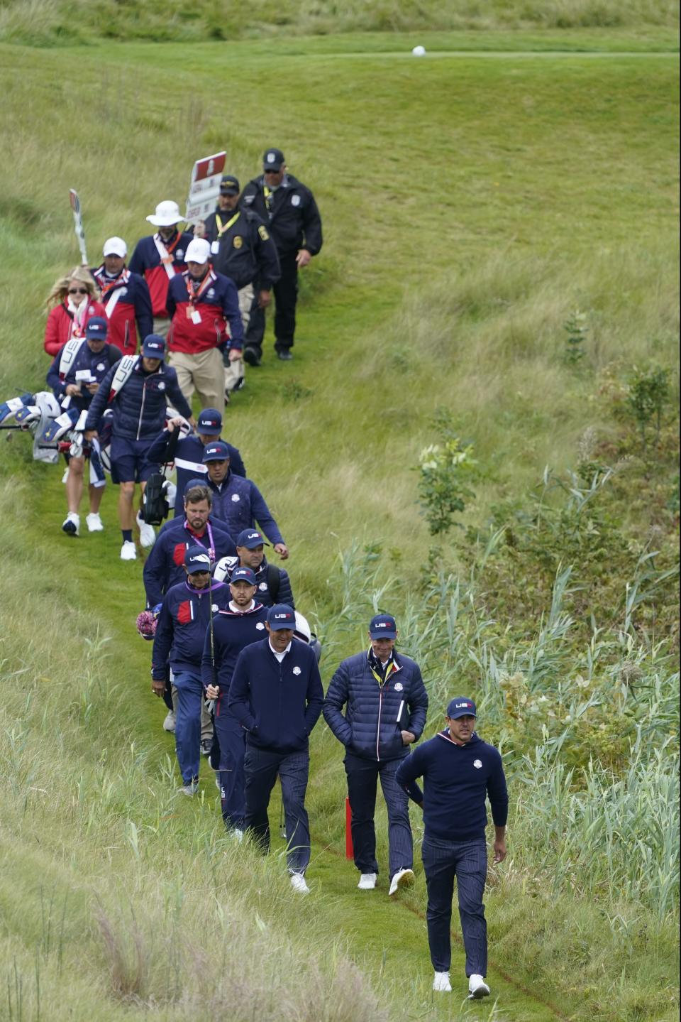 Team USA's Brooks Koepka and other team USA members walk off the 10th tee during a practice day at the Ryder Cup at the Whistling Straits Golf Course Wednesday, Sept. 22, 2021, in Sheboygan, Wis. (AP Photo/Charlie Neibergall)