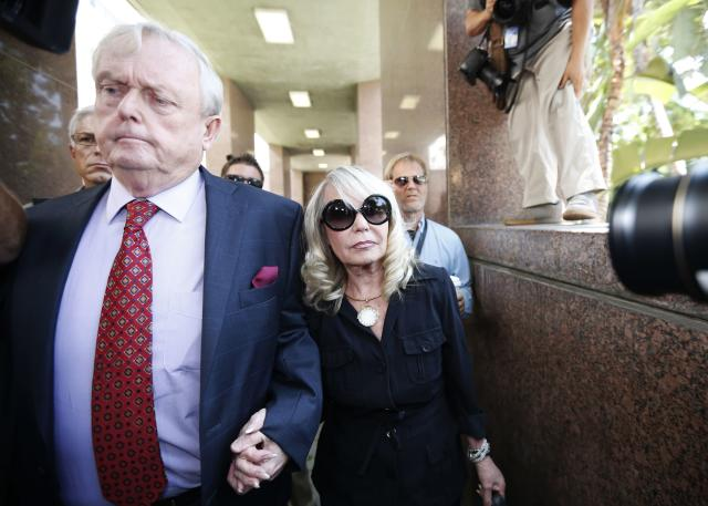 Shelly Sterling (R), 79, arrives at court with her lawyer Pierce O'Donnell in Los Angeles, California July 8, 2014. The $2 billion sale of the NBA's Los Angeles Clippers faces a key legal hurdle on Tuesday as the estranged husband and wife who own the franchise battle in court over control of the team. Shelly Sterling, 79, has asked a Los Angeles judge to confirm her as having sole authority to sell the pro basketball franchise to former Microsoft Corp chief executive Steve Ballmer at an NBA-record price after husband Donald Sterling vowed to block the deal. REUTERS/Lucy Nicholson (UNITED STATES - Tags: CRIME LAW SPORT BASKETBALL BUSINESS)