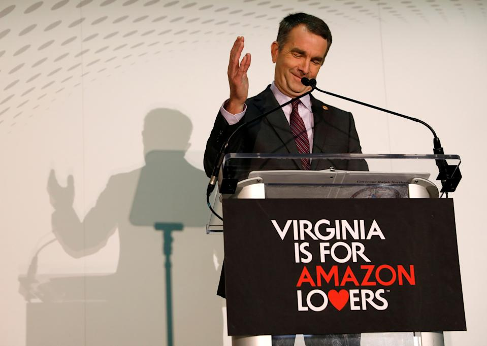 "Behind a ""Virginia is for Amazon Lovers"" sign, Virginia Governor Ralph Northam speaks at a news conference after the announcement that Crystal City has been selected as home to Amazon's new headquarters in Arlington, Virginia, U.S., November 13, 2018. REUTERS/Kevin Lamarque"