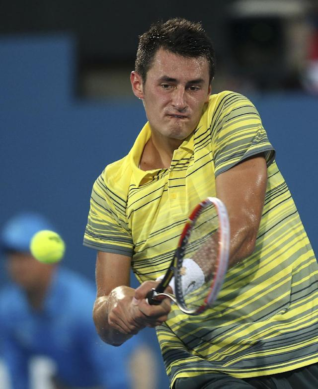 Bernard Tomic of Australia plays a backhand shot in his finals match against Juan Martin del Potro of Argentina during the Sydney International Tennis Tournament in Sydney, Australia, Saturday, Jan. 11, 2014. Del Potro won the match 6-3, 6-1. (AP Photo/Rob Griffith)