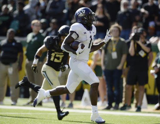 FILE - In this Nov. 17, 2018, file photo, TCU wide receiver Jalen Reagor scores past Baylor cornerback Raleigh Texada in the second half of an NCAA college football game, in Waco, Texas. Rhule may have only been joking when he said he sometimes still wakes up in the middle of the night haunted by the memory of those highlight plays TCUs Jalen Reagor made against the Bears last season. But that was in the last loss for the Bears, when Reagor pretty much single-handedly beat them by turning a screen pass into a 65-yard touchdown and running 37 yards for a score on a fourth-and-1 reverse. (Ernesto Garcia/Waco Tribune-Herald via AP, File)
