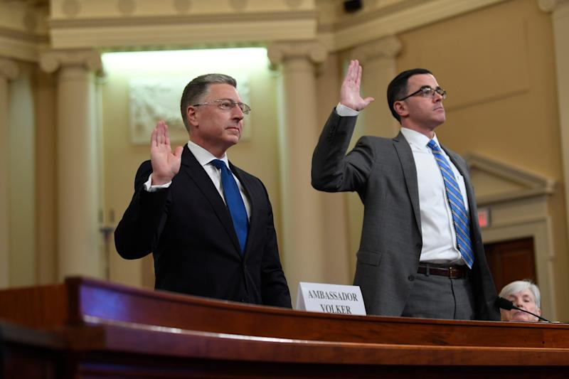 Ambassador Kurt Volker, the former U.S. special envoy for Ukraine, left, and National Security Council official Timothy Morrison are sworn before testifing before the Permanent Select Committee on Intelligence in a public hearing on Nov. 19, 2019.