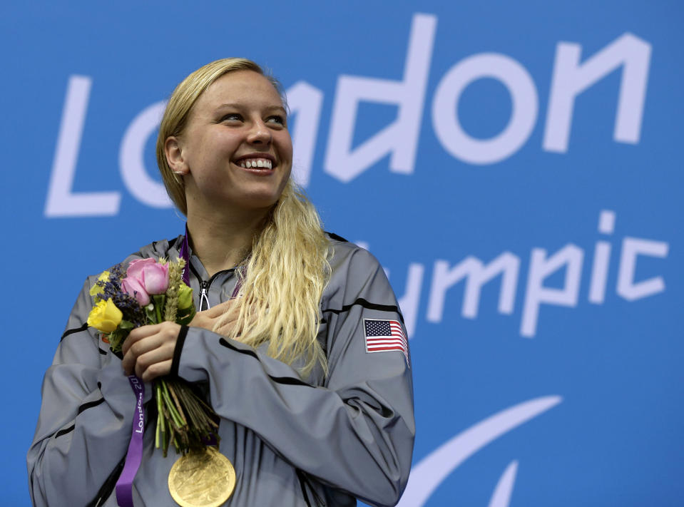 FILE - In this Saturday, Sept. 1, 2012 file photo, Jessica Long of the United States poses with her gold medal during the medal ceremony for the women's 100-meter breaststroke SB7 at the 2012 Paralympics game in London. NBC will air coverage of the Paralympics for the first time in primetime later this summer when the Summer Paralympic Games take place in Tokyo. NBCUniversal announced on Wednesday, Feb. 24, 2021 that 1,200 hours of programming will air across NBC's linear and digital channels. (AP Photo/Alastair Grant, File)