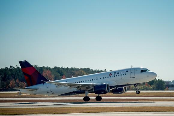 Delta aircraft taking off from runway