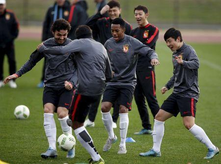 FILE PHOTO - Guangzhou Evergrande's Ricardo Goulart, Paulinho, Robinho and Zheng Long (L-R) take part in a training session ahead of their Club World Cup semi-final soccer match against Barcelona in Yokohama, south of Tokyo, Japan, December 15, 2015. REUTERS/Toru Hanai Picture Supplied by Action Images