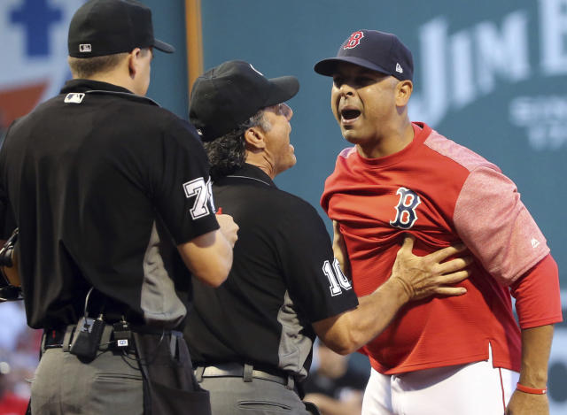 Boston Red Sox manager Alex Cora gives an earful to home plate umpire Adam Hamari after the Red Sox and Yankees were warned during an intense first inning. (AP)