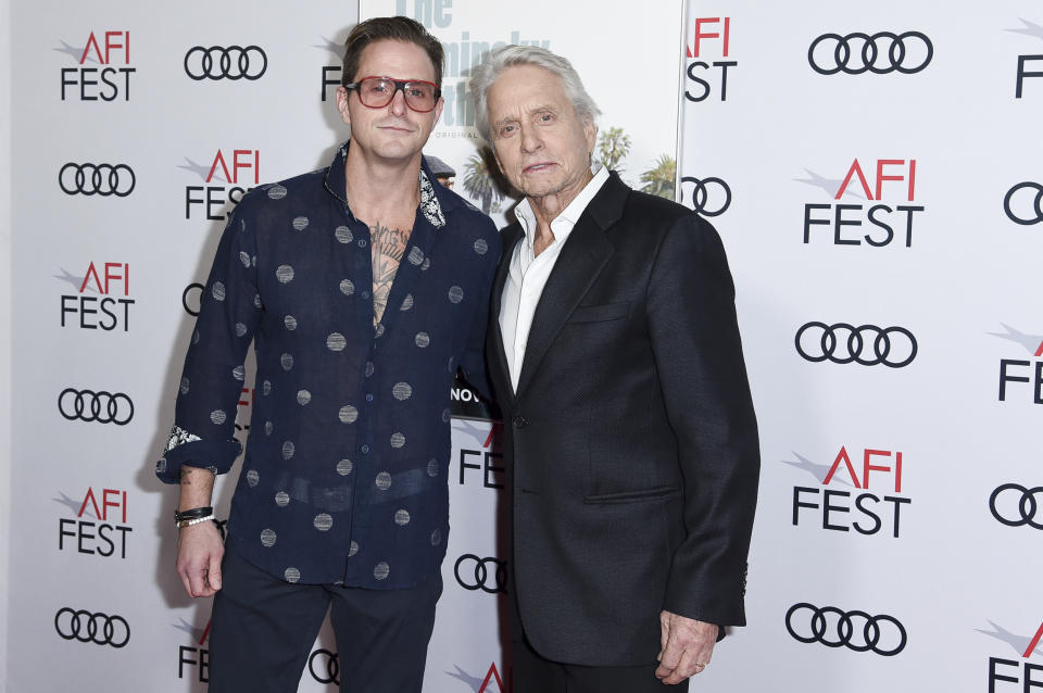 """Cameron Douglas, left, and Michael Douglas attend the world premiere of """"The Kominsky Method"""" during the 2018 AFI Fest at the Egyptian Theatre on Friday, Nov. 9, 2018, in Los Angeles. (Photo by Richard Shotwell/Invision/AP)"""
