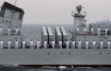File photo of Chinese Navy sailors taking part in an international fleet review to celebrate the 60th anniversary of the founding of the People's Liberation Army Navy in Qingdao