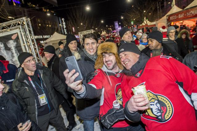 <p>Senators fans brave the cold to pose for a selfie with Prime Minister Justin Trudeau before the action got underway at the NHL 100 Classic Saturday. </p>