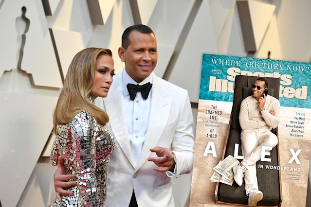 Alex Rodriguez poses with his fiancee Jennifer Lopez at an event. (Getty Images)